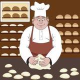 Baker fait le pain ou les petits pains dans une boulangerie Image stock