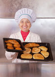 Baker with fresh pastries Royalty Free Stock Image