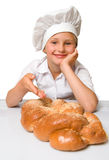 Baker girl. Little baker girl with twist bread loaf Royalty Free Stock Photography