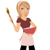 Baker girl. Blonde woman stirring batter in mixing bowl with wooden spoon Stock Image