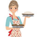 Baker girl with pies Royalty Free Stock Photography