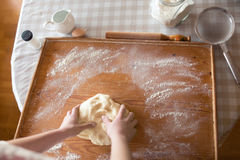 Baker hands kneading dough Stock Photos