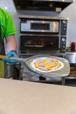 Baker hands with shovel, cooking pizza Royalty Free Stock Photos