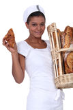 Baker with her bread Royalty Free Stock Images