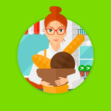 Baker holding basket with bakery products. Royalty Free Stock Images