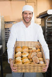 Baker holding basket of bread Royalty Free Stock Photography