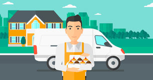 Baker holding box of cakes. Stock Images