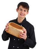 Baker holding bread Stock Photo