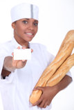 Baker holding bread Royalty Free Stock Images