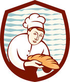 Baker Holding Bread Loaf Shield Retro. Illustration of a baker chef cook holding loaf of bread set inside shield done in retro style Stock Photos