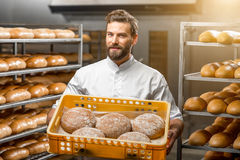 Baker holding breads at the manufacturing Royalty Free Stock Photography