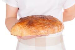 Baker holding fresh made bread. Stock Image