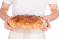 Baker holding fresh made bread. Royalty Free Stock Images