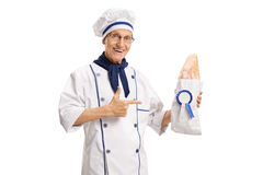 Free Baker Holding Loaf Of Bread With Award Ribbon And Pointing Royalty Free Stock Image - 94446016