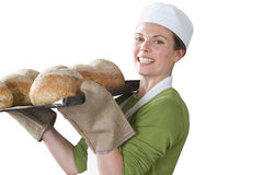 Baker holding pan of fresh bread loves Stock Photos