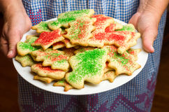 Baker holding a plate of homemade cookies Royalty Free Stock Photo