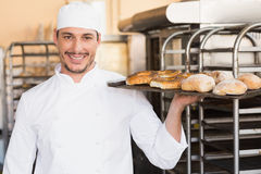 Baker holding tray of bread Royalty Free Stock Photography