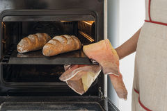 Baker holding tray with bread Royalty Free Stock Photography