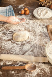 Baker is holing flour on his palm. Royalty Free Stock Image