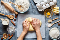 Baker knead dough bread, pizza or pie recipe ingridients with hands, food flat lay Royalty Free Stock Photo