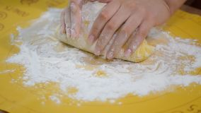 Baker kneading dough in flour on table. stock video