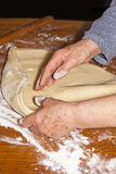 Baker kneading dough Royalty Free Stock Image