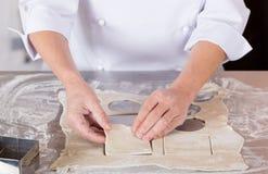 Baker kneading dough Stock Photos