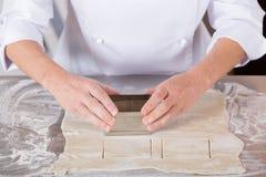 Baker kneading dough Stock Photography