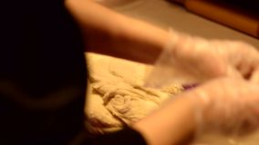 Baker kneading dough on table stock footage