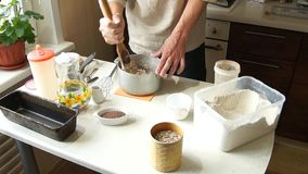 The baker kneads the dough stock video