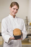 Baker with Loaf of Bread Stock Photo