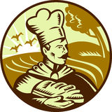 Baker loaf of bread with farm. Done in retro woodcut style, imagery shows a baker holding a loaf of bread with farm in the background. Three (3) colors used in Stock Images