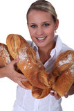 Baker with loaves Royalty Free Stock Images