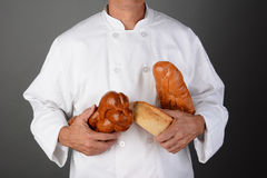 Baker With Loaves of Bread Stock Photos