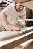 Baker makes the bread. Kneaded in the oven Royalty Free Stock Images