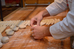 Baker makes bread Royalty Free Stock Photos