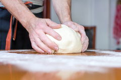 Baker makes bread on the table Stock Images