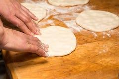 Baker making bun of dough Stock Images