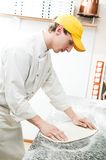 Baker making dough for Pizza Royalty Free Stock Photography