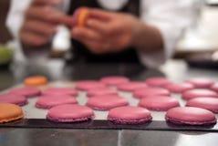 Baker making macaron dessert Stock Photos