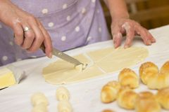 Baker making mini croissants, close up Royalty Free Stock Photo