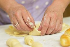 Baker making mini croissants, close up Stock Photos