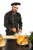 Baker male mixing dough Stock Photography