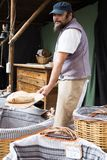 Baker posing with shovel and grain dough royalty free stock image
