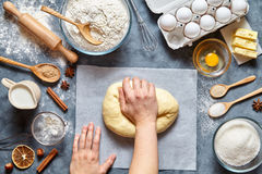 Baker mixing dough bread, pizza or pie recipe ingridients, food flat lay Royalty Free Stock Photo