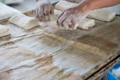 Baker Placing Raw Ciabatta Bread on Tray Stock Images