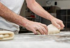 Baker prepares bread dough. The baker prepares bread dough Stock Photo