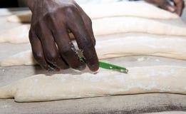 The baker prepares bread dough. The baker prepares a bread dough Stock Photos