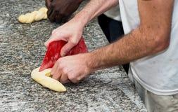 The baker prepares bread dough. The baker prepares a  bread dough Royalty Free Stock Photos