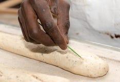 Baker prepares bread dough, french baguettes. The baker prepares bread dough, french baguettes Stock Images